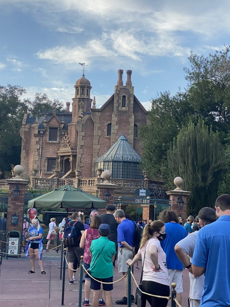 disney world crowds in front of haunted mansion