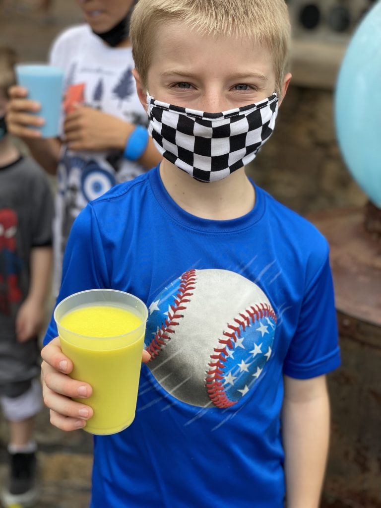 boy at disney with a mask on