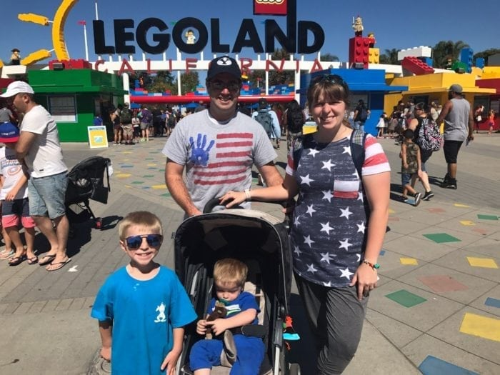 family in front of legoland california.